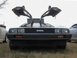 A photo of a DeLorean car with the gullwing doors open