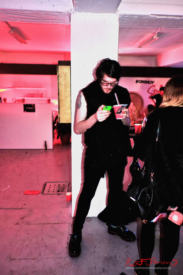 Black jeans and sleevless tee, green phone, red Stoli cocktail; ORGNL.TV - Stolichnaya Vodka, Sydney Launch Party