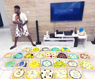 Music artiste Reekado Banks,cakes,lots of cakes