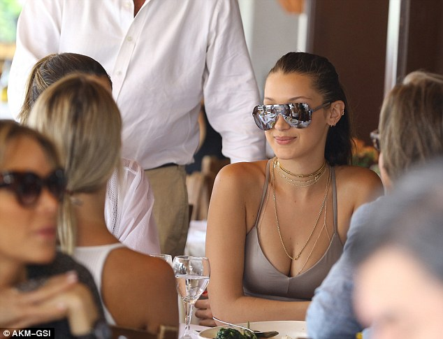 Bella Hadid shows off flat midriff and toned physique in bodycon nude crop top and matching leggings