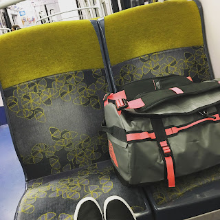 traveling solo female woman wanderlust europe backpack paris france metro north face