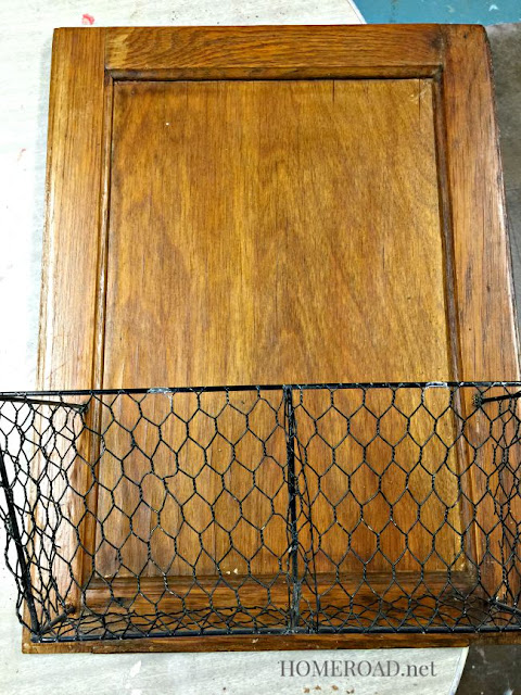 Vintage cabinet door with black wire basket
