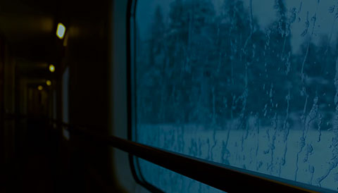 View from the corridor of a train on a long snowy journey. Relaxing switch activity.