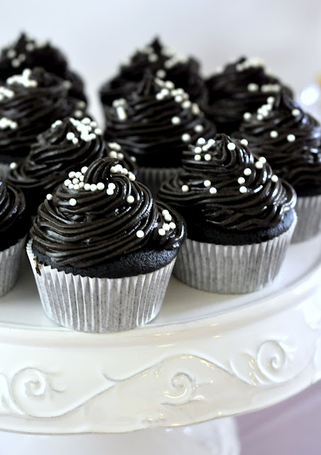 Chocolate Cupcakes with Dark Buttercream Frosting on an Antique Store Cake Stand | Taste As You Go