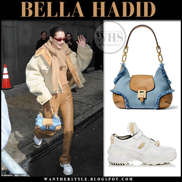 Bella Hadid in shearling jacket, leather pants with denim and leather micheal kors bancroft bag and white maison margiela sneakers fashion week outfits february 13