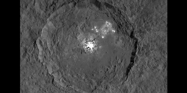 This image taken from NASA's Dawn spacecraft in orbit around the dwarf planet Ceres shows the very bright patches of material in the crater Occator and elsewhere. New observations using the HARPS spectrograph on the ESO 3.6-metre telescope at La Silla in Chile have revealed unexpected daily changes on these spots, suggesting that they change under the influence of sunlight. Credit: NASA/JPL-Caltech/UCLA/MPS/DLR/IDA