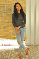 Actress Bhanu Tripathri Pos in Ripped Jeans at Iddari Madhya 18 Movie Pressmeet  0028.JPG