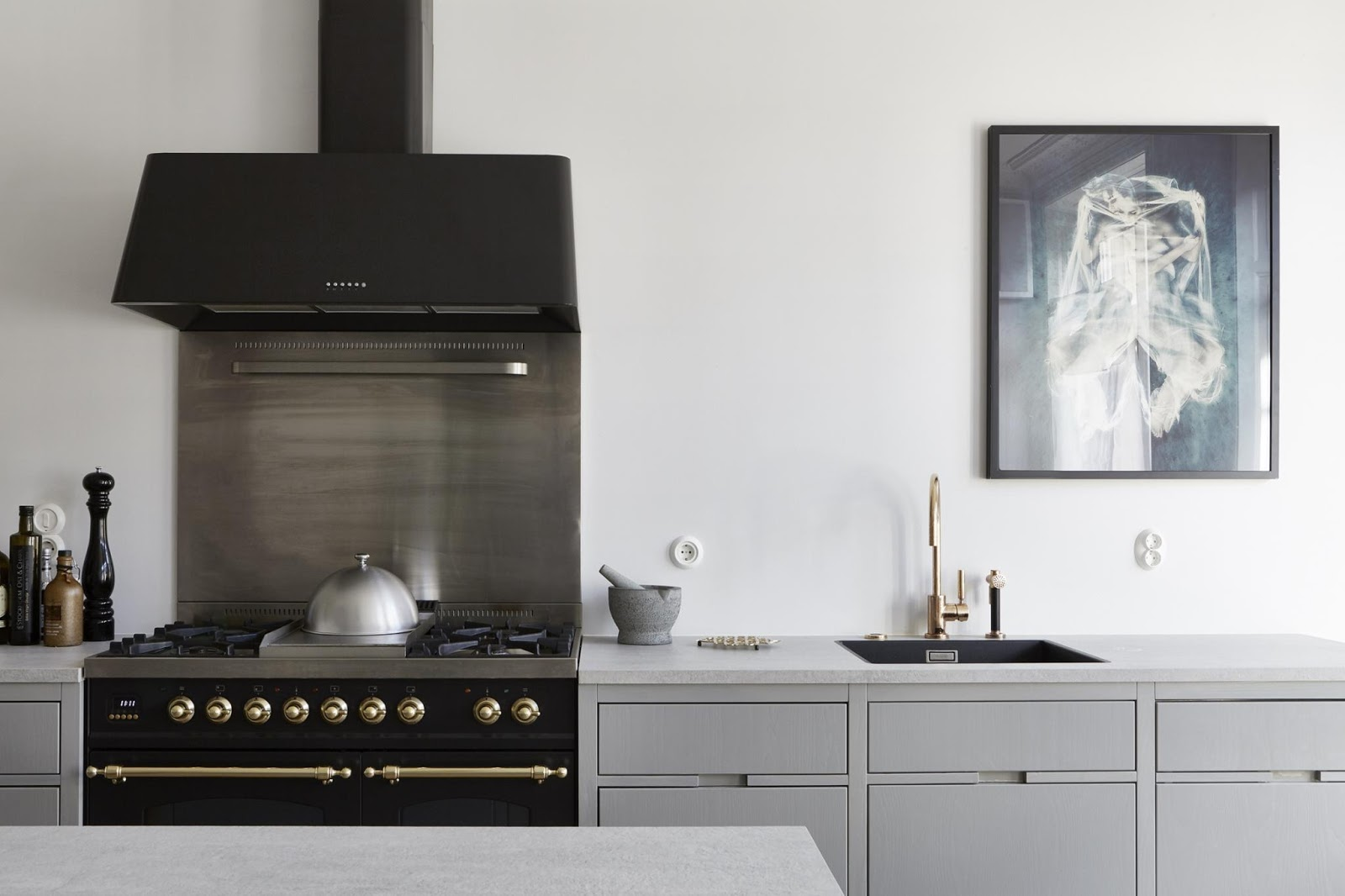 retro stove in the gray and gold kitchen, scandinavian design