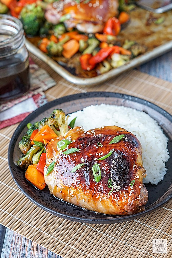 Baked Teriyaki Chicken Thigh with roasted vegetables and rice on a plate ready to eat