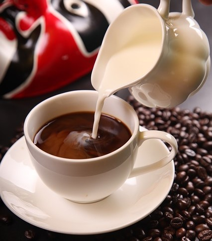 Coffee%2B %2BPouring%2Bin%2BCream How Many Calories In A Cup Of Coffee With Cream