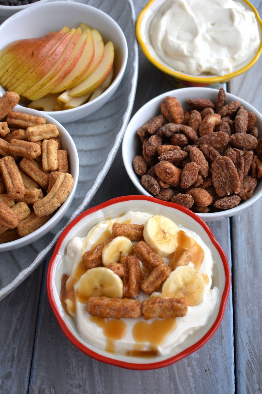Churros, bananas and caramel yogurt bowl