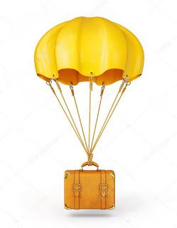 жёлтый парашют с чемоданом