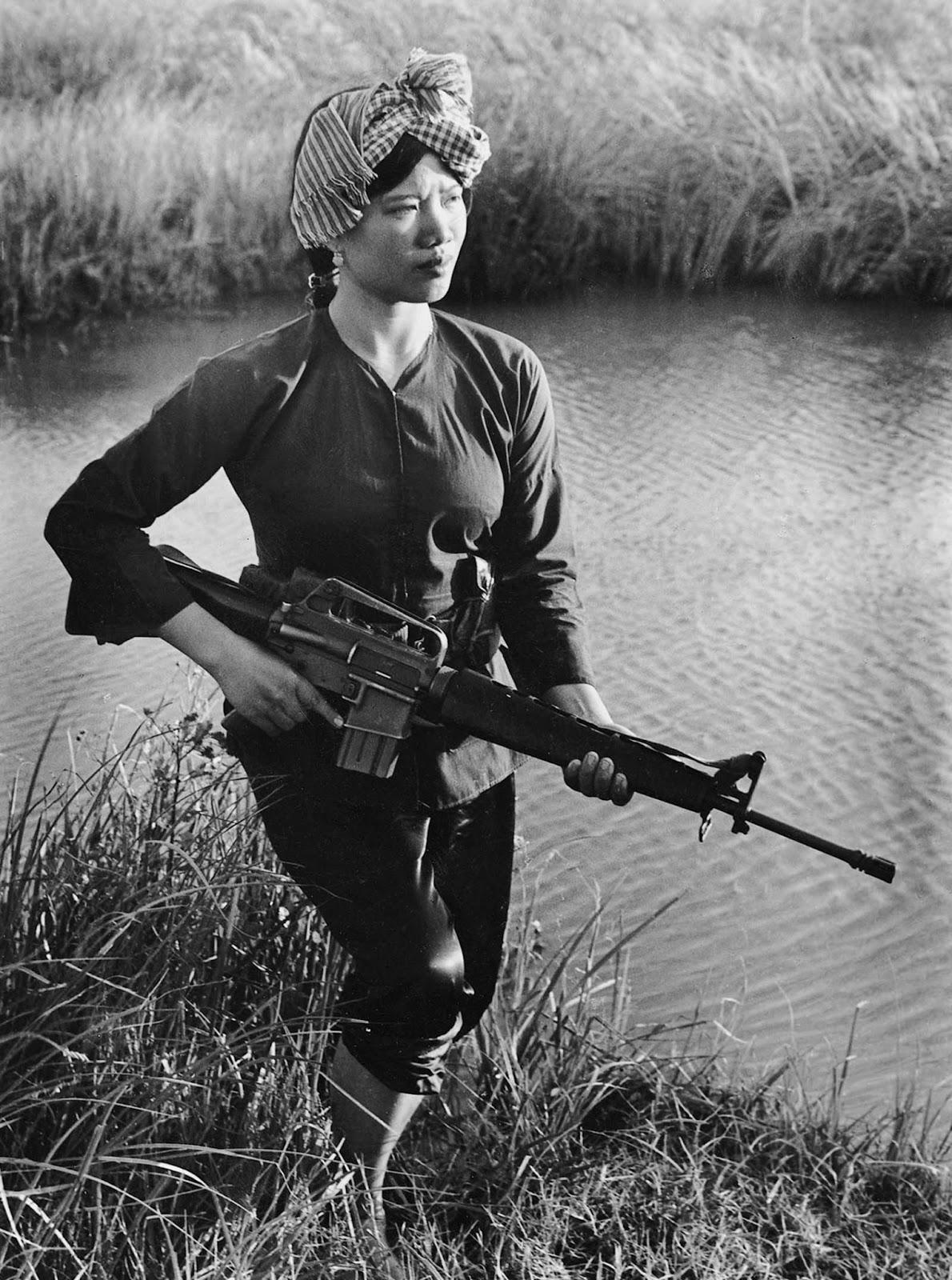 A Viet Cong guerrilla stands guard in the Mekong Delta.