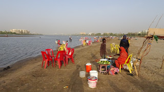 People enjoy Tuti island in the late afternoon