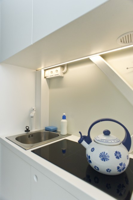 Picture of white small kitchen furniture in the world's narrowest house