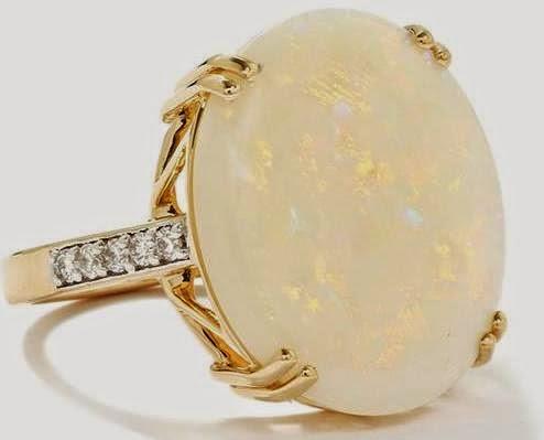 http://www.gemporia.com/en-gb/product/australian-opal-and-diamond-14k-gold-tomas-rae-ring-atgw-7.07cts/akps19/