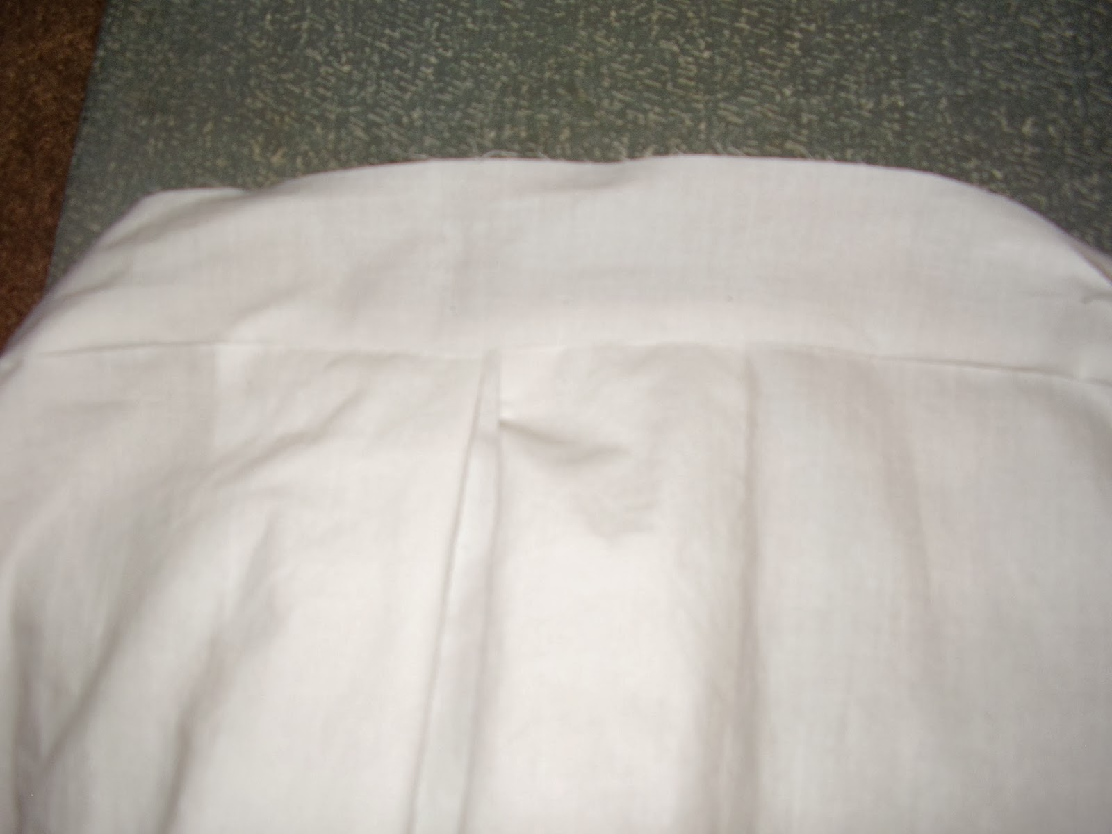 Close-up of chemise upper band.