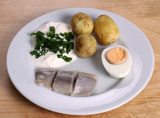 Traditional pickled herring served for the midsummer holiday