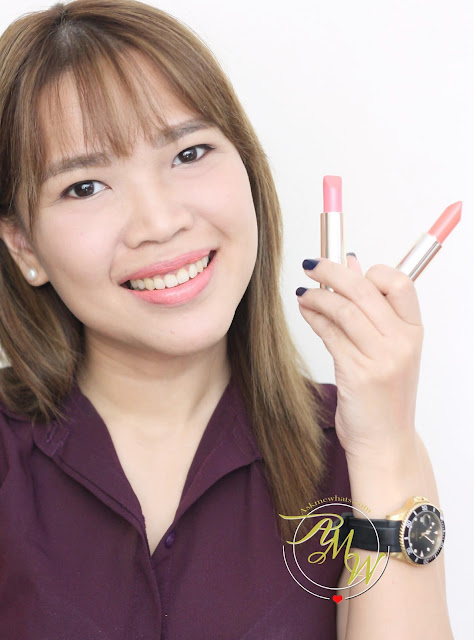 a photo of askmewhats wearing Estee Lauder NEW Pure Color Love review in Sky High and Sly Wink