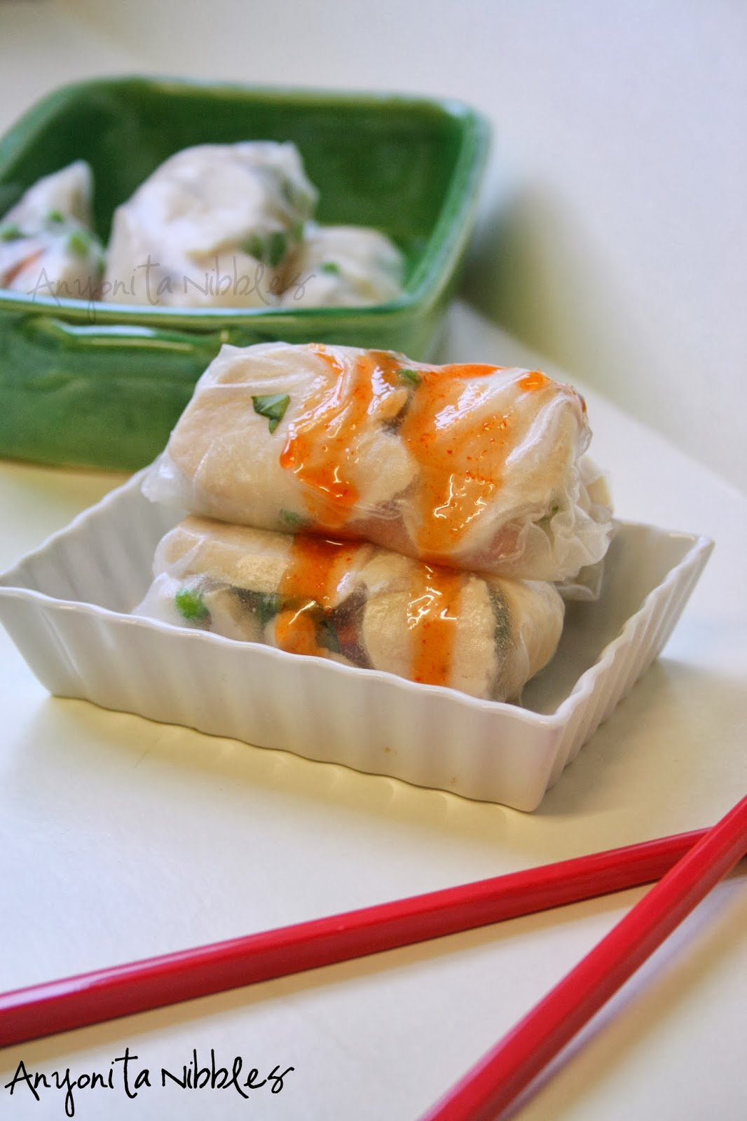 Honeyed Srirachadip over chicken rice paper rolls | Anyonita Nibles