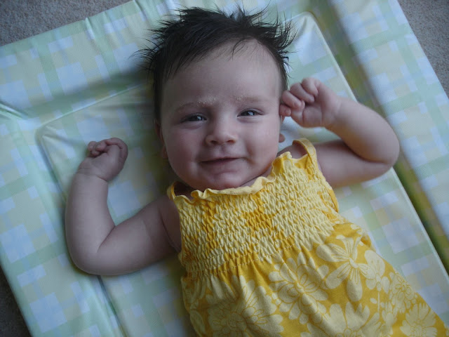 photo of Sasha as a baby, smiling