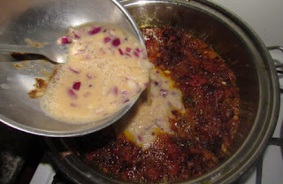 Adding whisked eggs to cooking sauce