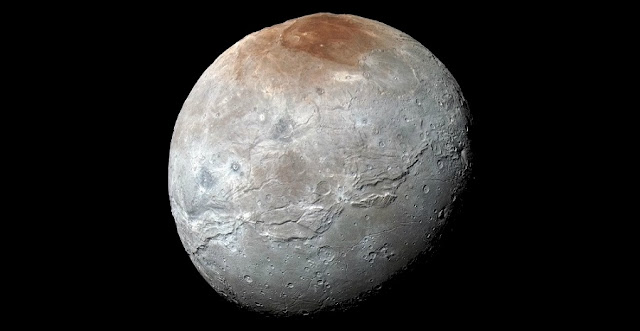 NASA's New Horizons captured this high-resolution enhanced color view of Pluto's moon Charon, showing the crack on the icy moon. It was taken just before closest approach on July 14, 2015. The image combines blue, red and infrared images and the colors are processed to best highlight the variation of surface properties across Charon. Credit: NASA