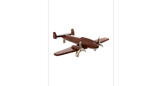 Linear wooden model aeroplane, from House of Fraser