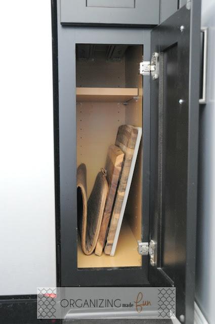 Small side cupboard for organizing cutting boards :: OrganizingMadeFun.com