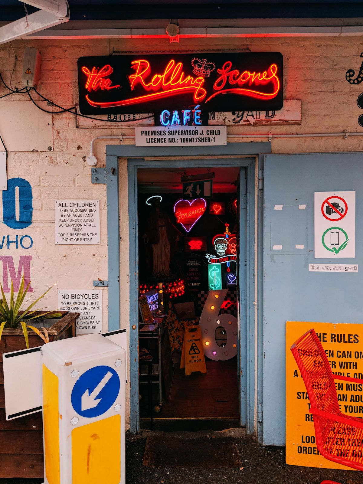 The entrance of God's Own Junkyard decorated with neon lights