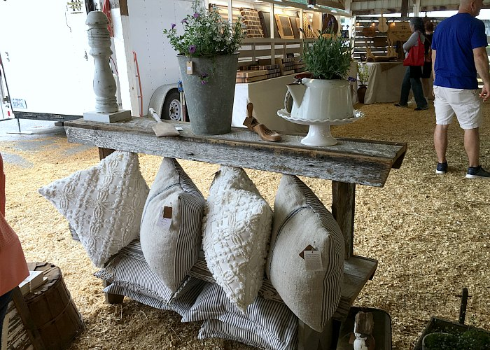 bedspread pillows, barnwood side table, junk, antique