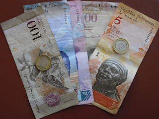 A selection of notes & coins of Venezuela's unfathomable currency - the Bolivar Fuerte.