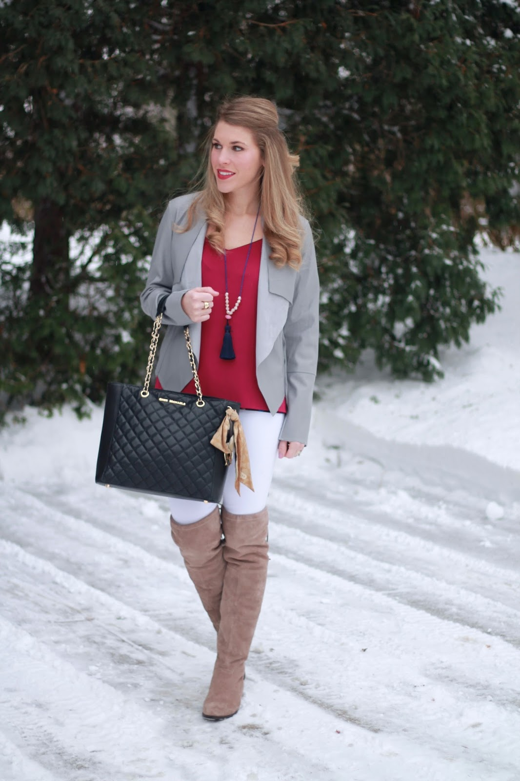 magenta barcelona cami, white jeans, grey moto jacket, OTK taupe boots, black Greg Michaels quilted tote, tassel necklace