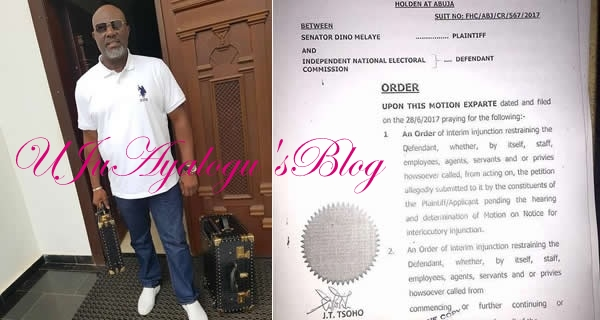 Dino Melaye 'Unbothered' As He Show Off Matching Portmanteau During His Recall Process