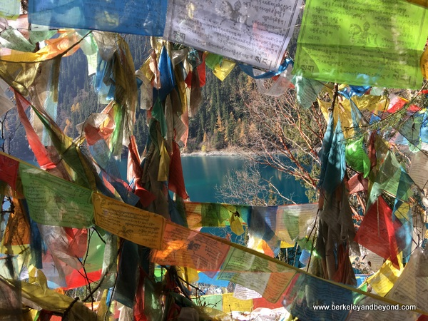 Tibetan prayer flags at Long Lake in Jiuzhaigou Valley National Park in Sichuan Province, China