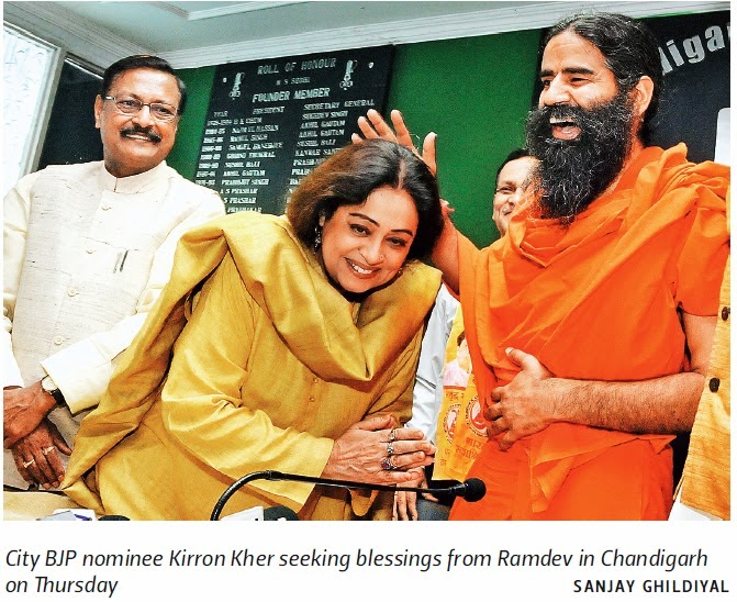 City BJP nominee Kirron Kher seeking blessings from Ramdev in Chandigarh. Alongwith Ex-MP Satya Pal Jain