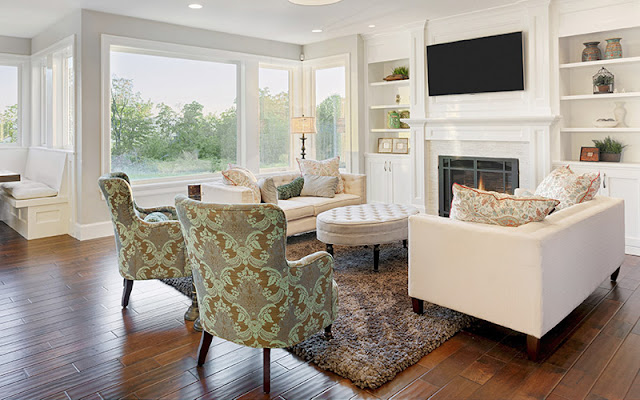 Area rug anchors furniture grouping in open living area