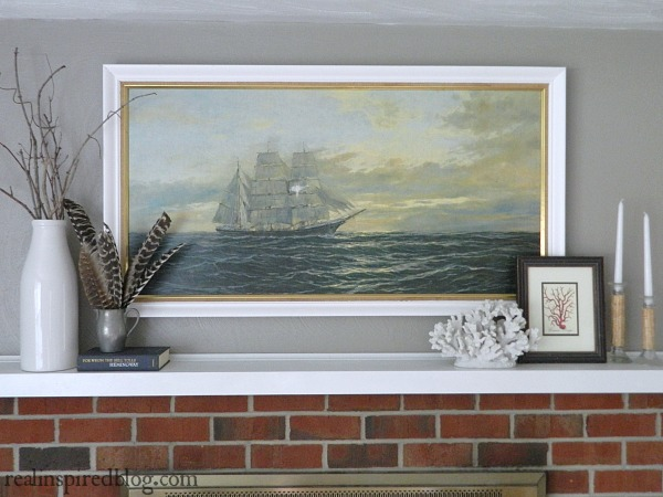 How to Decorate a Long Mantel:nautical theme, feathers, coral, candles, sticks, ship