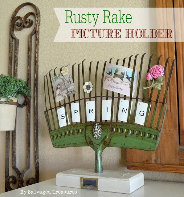 Repurposed rusty rake transformed into a picture holder