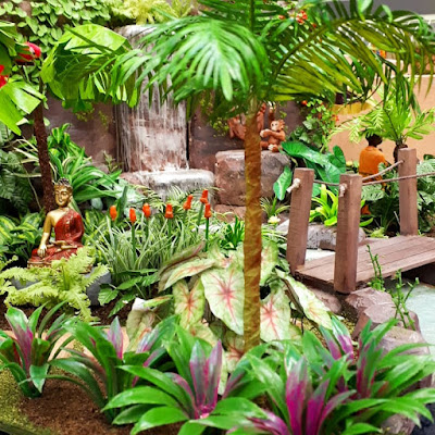 One-twelfth scale tropical garden with waterfall and buddha statue