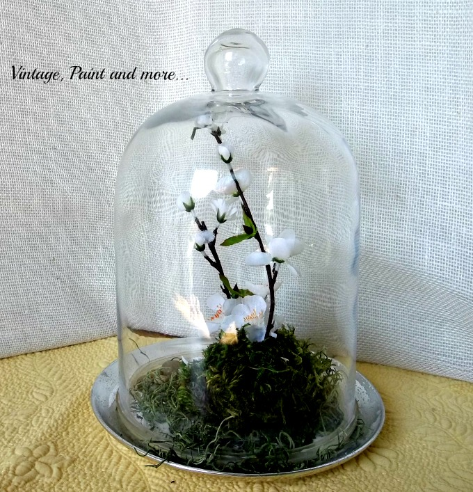 Spring in a Cloche - moss covered styrofoam with faux dogwood in a thrifted cloche