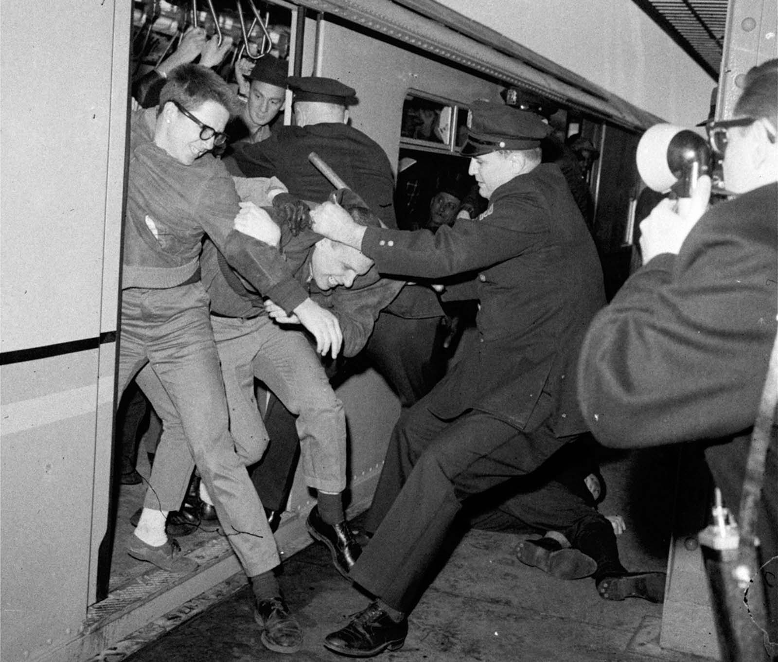 New York City policemen tangle with demonstrators at a subway station on the opening day of the New York World's Fair, April 22, 1964. Youths attempted to stall the train, which was headed from the city to the fairgrounds, as a form of protest on behalf of civil rights for blacks.