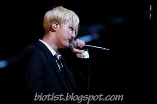 Photos of Jin BTS singin on the stage