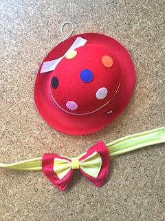 Lustige Karnevalszeit, Verkleidung: Bunter Hut und gelb- rote Fliege