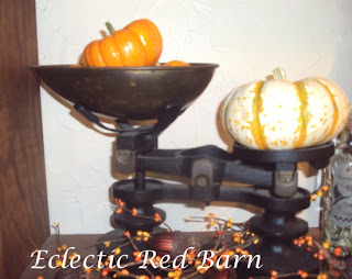 vintage scale with pumpkins and acorns and fall berries