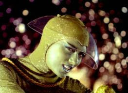 A seductive green alien in Lost In Space 1965 movieloversreviews.blogspot.com
