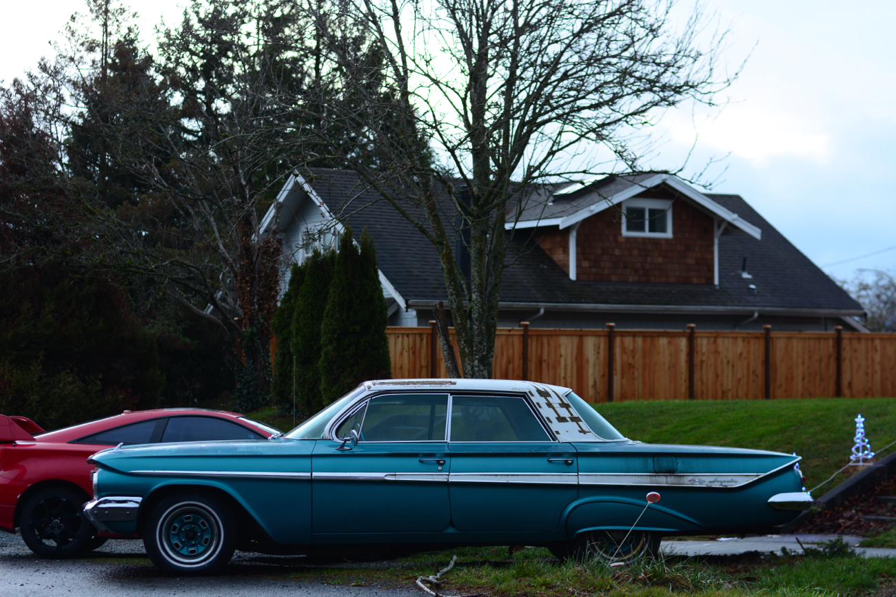 OLD PARKED CARS.: 1961 Chevrolet Impala.