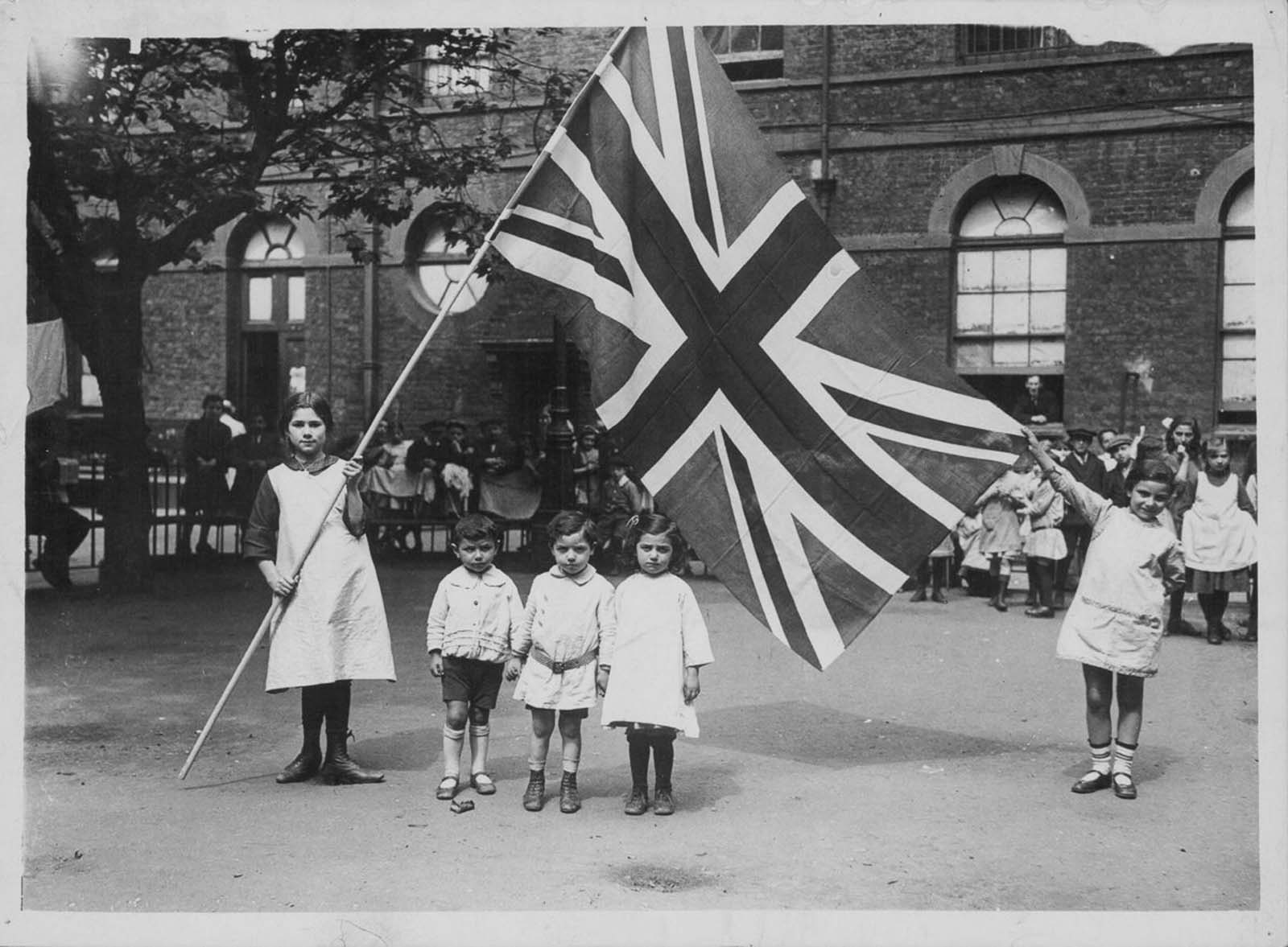 Belgian refugees in London celebrate Independence Day. 1915.