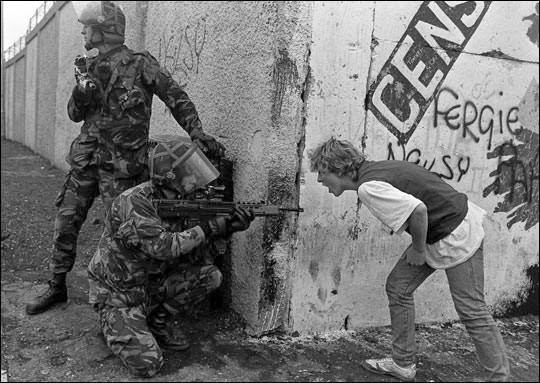An Irish teenager yells at British soldiers during unrest in Northern Ireland. - The 63 Most Powerful Photos Ever Taken That Perfectly Capture The Human Experience