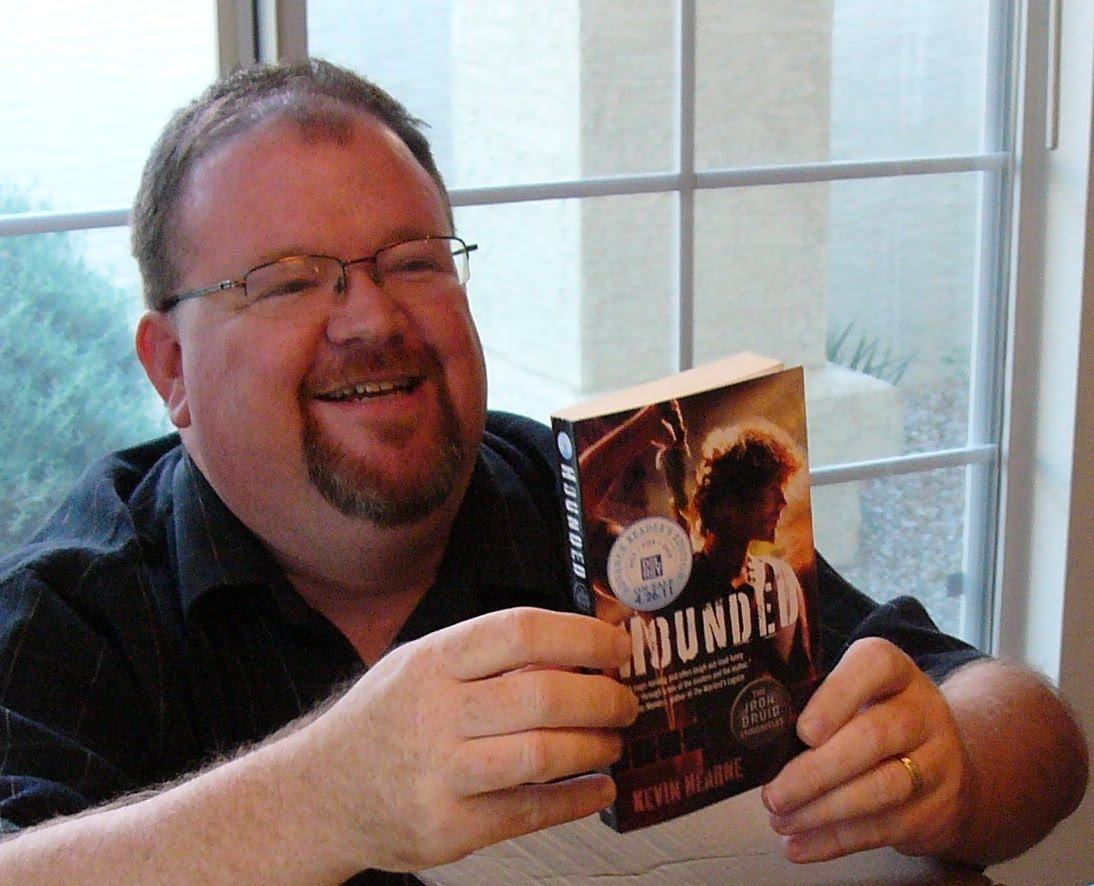 Photo of Kevin Hearne holding Hounded